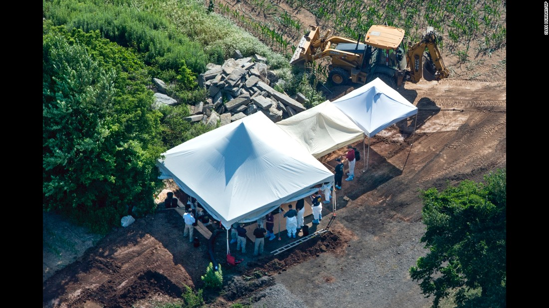 "Investigators gather under tents in Solebury Township, Pennsylvania, as they search a property for four missing men on Wednesday, July 12. The men went missing over several days last week within miles of each other. At least one of the men's bodies <a href=""http://www.cnn.com/2017/07/13/us/pennsylvania-missing-men/index.html"" target=""_blank"">has been found</a> on the property, authorities said. Additional human remains were found but have yet to be identified."