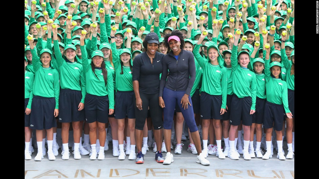 Venus and Serena pose with Australian Open ball kids in January 2017.