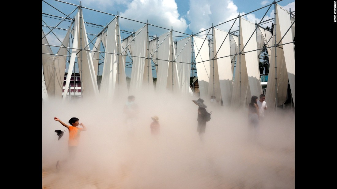 "A boy plays in ""Mist Encounter,"" an installation at a fine-arts museum in Taipei, Taiwan, on Tuesday, July 11."