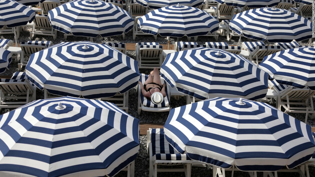 A woman enjoys a beach in Nice, France, on Tuesday, July 11.