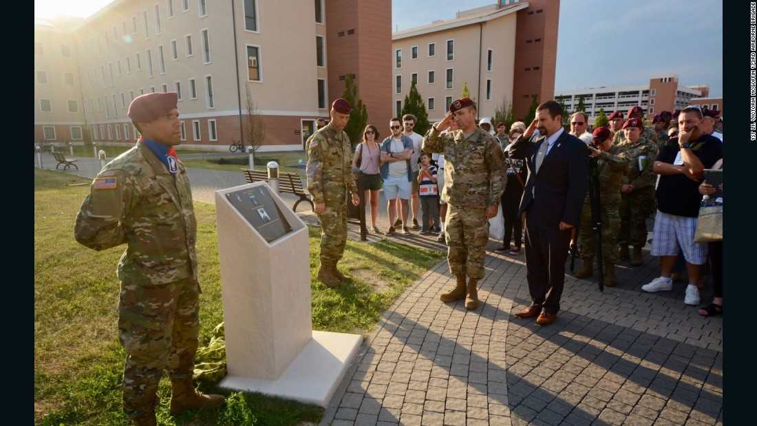 Anderson and Giunta salute at the dedication for the Medal of Honor Walkway outside of the 173rd Airborne Brigade Headquarters Building.
