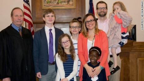 "The Davises in court the day an Ohio judge made Mata's adoption official. Mata bonded with her new siblings quickly, Jessica says: ""They were playing tag; they were doing bubbles. ... It was amazing."""