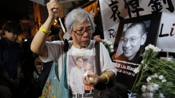 A protester cries as she mourns Liu Xiaobo during a demonstration outside the Chinese liaison office in Hong Kong, Thursday, July 13.