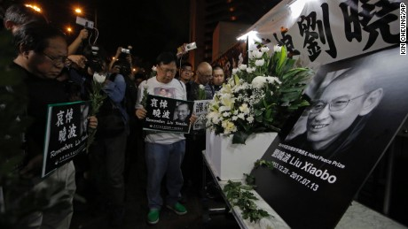 Protesters mourn jailed Chinese Nobel Peace laureate Liu Xiaobo, who died at the age of 61.