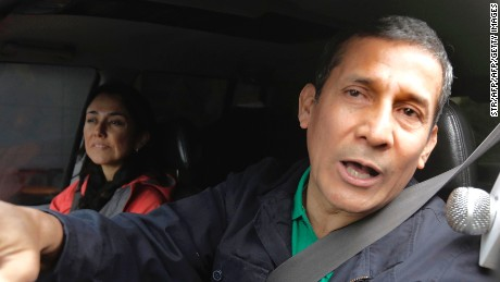 Peruvian former president Ollanta Humala speaks to the press as he leaves his home next to his wife Nadine Heredia in Lima on July 13, 2017.  Prosecutors in Peru have requested the arrest of former President Ollanta Humala and his wife Nadine Heredia on money laundering and conspiracy charges tied to a corruption scandal involving Brazilian construction company Odebrecht. / AFP PHOTO / STR        (Photo credit should read STR/AFP/Getty Images)
