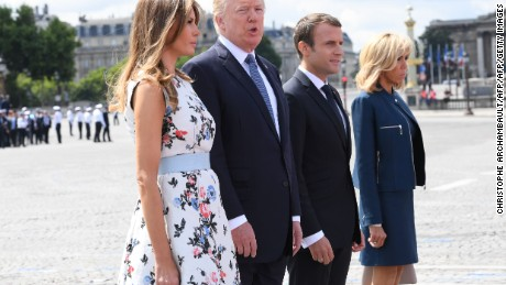 French President Emmanuel Macron (2nd R) and his wife Brigitte Macron (R) stand with US President Donald Trump and US First Lady Melania Trump after attending the annual Bastille Day military parade on the Champs-Elysees avenue in Paris on July 14, 2017. The parade on Paris's Champs-Elysees will commemorate the centenary of the US entering WWI and will feature horses, helicopters, planes and troops. / AFP PHOTO / POOL / CHRISTOPHE ARCHAMBAULT        (Photo credit should read CHRISTOPHE ARCHAMBAULT/AFP/Getty Images)