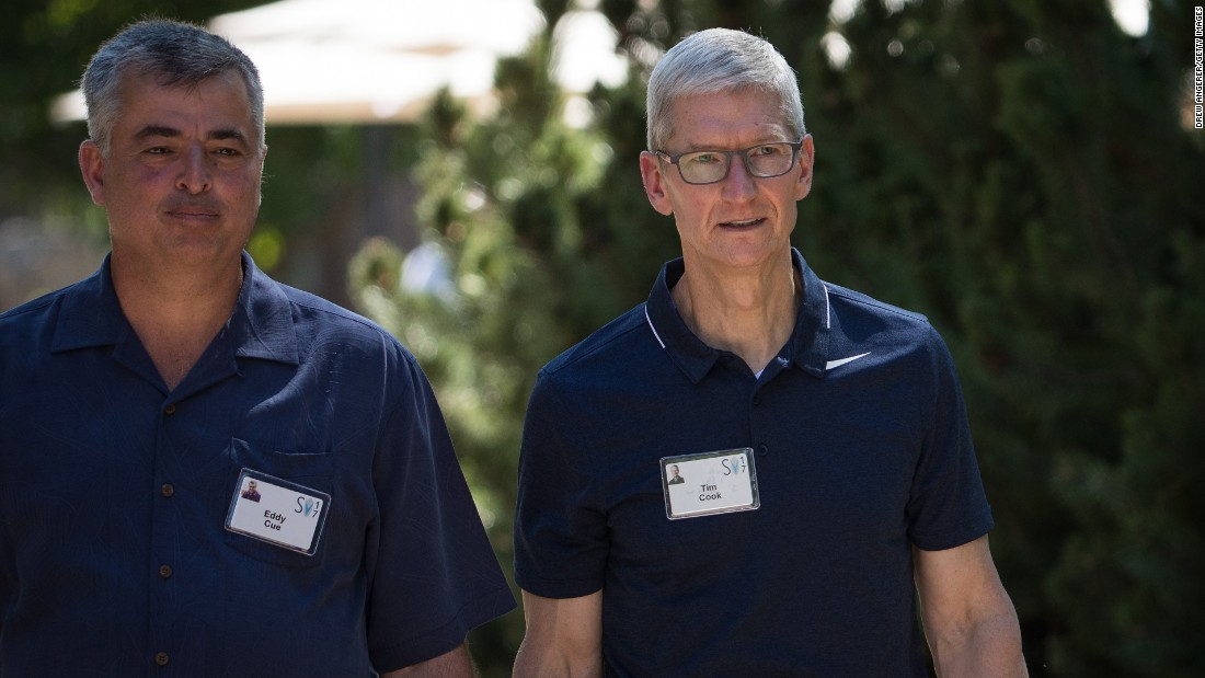 Apple CEO Tim Cook, right, walks with Eddy Cue, Apple's senior vice president of internet software and services, at the Allen & Co. Sun Valley Conference on Wednesday, July 12. The annual weeklong conference, held in Sun Valley, Idaho, brings together some of the world's most wealthy and powerful businesspeople. See some of the corporate titans attending the event this year.
