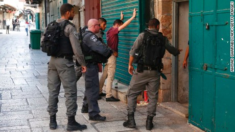 Israeli security forces frisk a Palestinian youth in Jerusalem's Old City following Friday's attack.