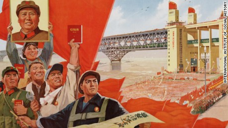 """The construction of the Nanjing Yangtze River Bridge is a great victory of Mao Zedong Thought!"" (1975) Celebrating the victory of the bridge's construction, this poster features illustrations of workers holding up a portrait of Mao Zedong. They are also seen with a copy of the Little Red Book."