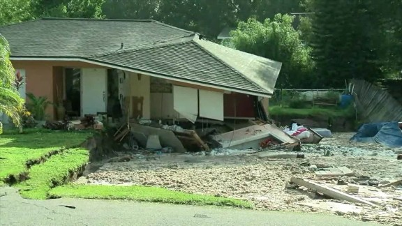 A house starts falling Friday into a sinkhole in Land O