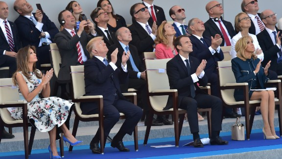 (FromL) US First Lady Melania Trump, US President Donald Trump, French President Emmanuel Macron and his wife Brigitte Macron attend the annual Bastille Day military parade on the Champs-Elysees avenue in Paris on July 14, 2017.