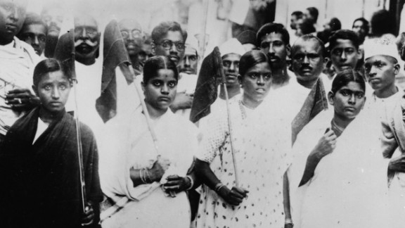 Indian women volunteers carry flags and parade through the streets of Madras, south India, protesting for the country