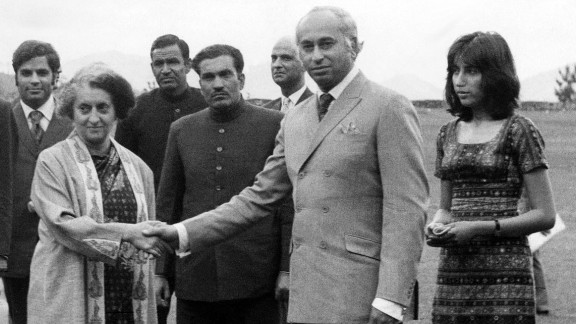 Then-Pakistani President Zulfikar Ali Bhutto (center) shakes hands with then-Indian Prime Minister Indira Gandhi (left). Gandhi succeeded her late father, Nehru, who passed away on May 27, 1964. Bhutto