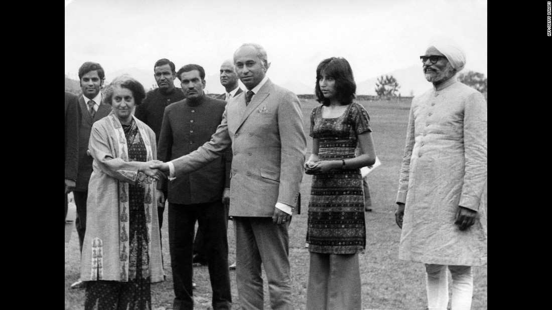 Then-Pakistani President Zulfikar Ali Bhutto (center) shakes hands with then-Indian Prime Minister Indira Gandhi (left). Gandhi succeeded her late father, Nehru, who passed away on May 27, 1964. Bhutto's daughter, Benazir (second right), and former Indian Foreign Minister Swaran Singh (right) look on in Shimla, a city in the Himalayan foothills of India on June, 28, 1972.<br /><br />The visit took place after a war broke out between the two nations in 1971, that led to the creation of Bangladesh, formerly known as East Pakistan. Bhutto visited India to meet Gandhi and negotiated a formal peace agreement. The two leaders signed the Shimla Agreement, which committed both nations to establish a Line of Control in Kashmir and obligated them to resolve disputes peacefully through bilateral talks.<br />Three more wars later, the last fought in 1999, peace is yet to be established.