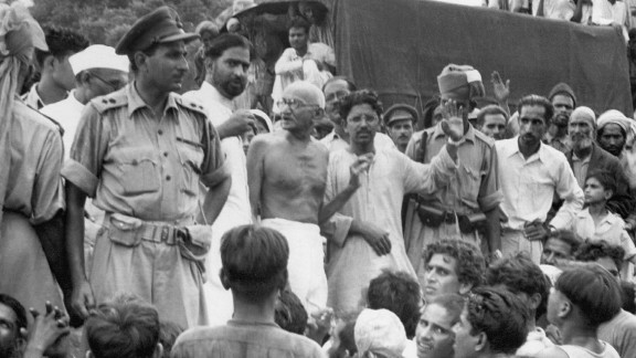 Gandhi (center) visits Muslim refugees as they prepare to depart for Pakistan at Purana Qila fort, New Delhi, on September 22, 1947.