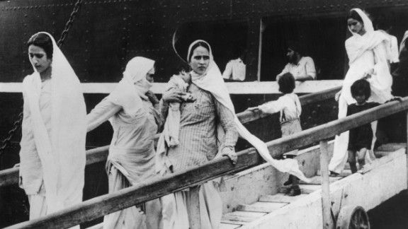 Hindu and Sikh women arrive in Mumbai with their children on a British-India liner after flying from Pakistan on October 9, 1947.  Women were the victims of brutal violence during partition. It is estimated that 75,000 women were abducted and raped.