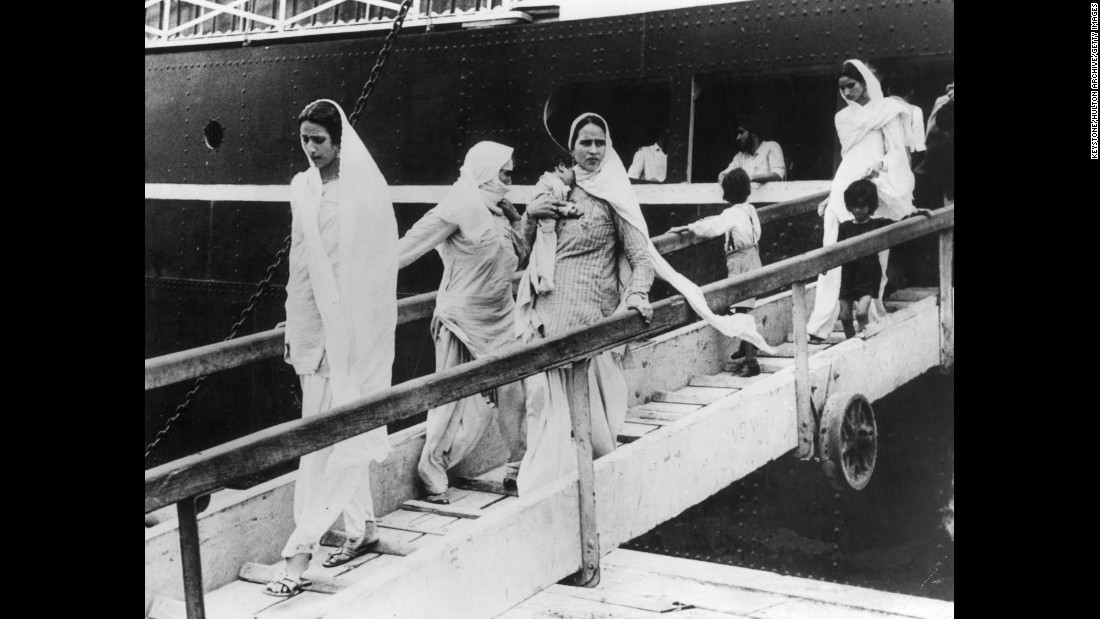 "Hindu and Sikh women arrive in Mumbai with their children on a British-India liner after flying from Pakistan on October 9, 1947.<br /><br />Women were the victims of brutal violence during partition. It is estimated that <a href=""http://www.newyorker.com/magazine/2015/06/29/the-great-divide-books-dalrymple"" target=""_blank"">75,000 women</a> were abducted and raped."