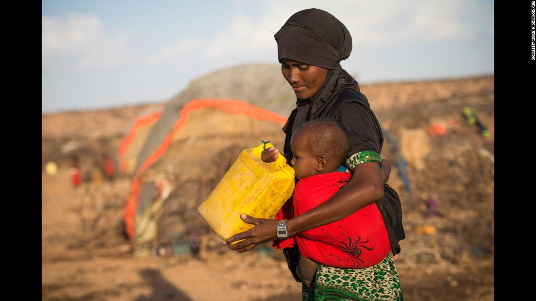 "Rhama Ismail shares some water with her 1-year-old daughter in Somalia.  ""I just don't know how my daughter will grow up or if she will go to school,"" she says. ""I am worried for her future."""