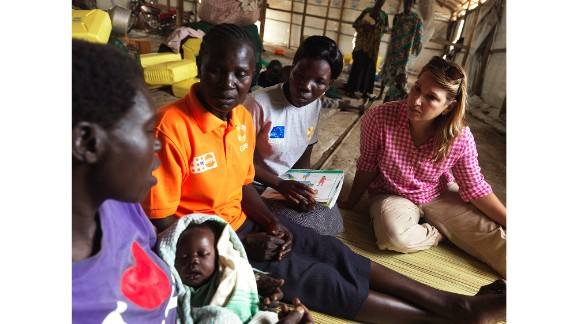 Heather Higginbottom sits with Esther, a refugee from South Sudan, who arrived in Uganda with her 3-week-old newborn.