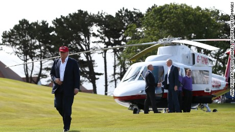 AYR, SCOTLAND - JULY 30:  Republican Presidential Candidate Donald Trump arrives by helicopter to visit his Scottish golf course Turnberry on July 30, 2015 in Ayr, Scotland. Donald Trump will answer questions from the media at a press conference where reporters will be limited to questions just about golf.  (Photo by Jan Kruger/Getty Images)