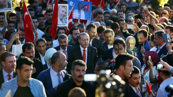 Turkey's President Recep Tayyip Erdogan, center, in Istanbul to commemorate the anniversary of the coup.
