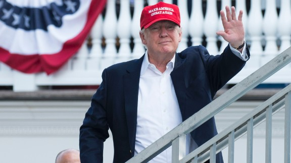 US President Donald Trump waves to well wishers as he arrives at the 72nd US Women's Open Golf Championship at Trump National Golf Course in Bedminster, New Jersey, July 15, 2017. / AFP PHOTO / SAUL LOEB        (Photo credit should read SAUL LOEB/AFP/Getty Images)