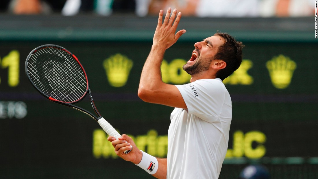 Cilic reacts after hitting the ball into the net.