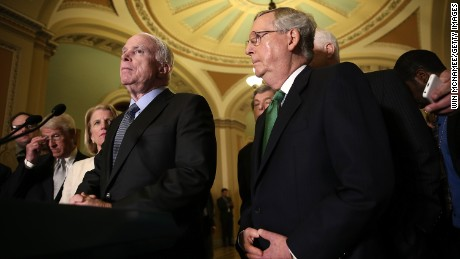 Sen. John McCain (L) (R-AZ) speaks with members of the Republican leadership, including Senate Majority Leader Mitch McConnell (R) about the Defense Authorization Bill following caucus luncheons at the U.S. Capitol June 9, 2015 in Washington, DC. The Senate is expected to begin voting on the Defense Authorization bill later this afternoon.