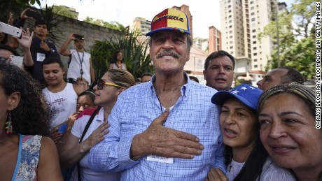 Vicente Fox, former President of Mexico, greets voters at a polling station during a symbolic Venezuelan plebiscite in Caracas, Venezuela, on Sunday, July 16, 2017. Voting is under way in the Venezuela opposition alliance's unofficial plebiscite, as it seeks to challenge the legitimacy of President Nicolas Maduro's plan to rewrite the constitution after four months of anti-government protests that have left almost 100 dead. Photographer: Carlos Becerra/Bloomberg via Getty Images