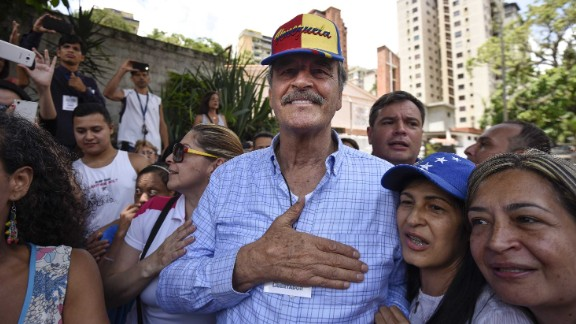 Fox greets voters at a Caracas polling station during the referendum Sunday.