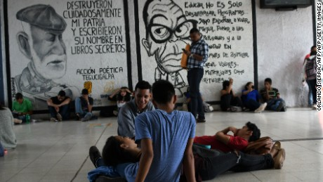 "Students of the National Autonomous University of Honduras (UNAH) members of the University Student Movement (MEU) occupy the university premises e to demand, among other things, the resignation of rector Julieta Castellanos, in Tegucigalpa, on July 3, 2017. The MEU also demands the cessation of the ""criminalization"" of protests, the suspension of student hearings and support to appoint delegates to the University Council, UNAH's main decision-making body. / AFP PHOTO / ORLANDO SIERRA.        (Photo credit should read ORLANDO SIERRA./AFP/Getty Images)"