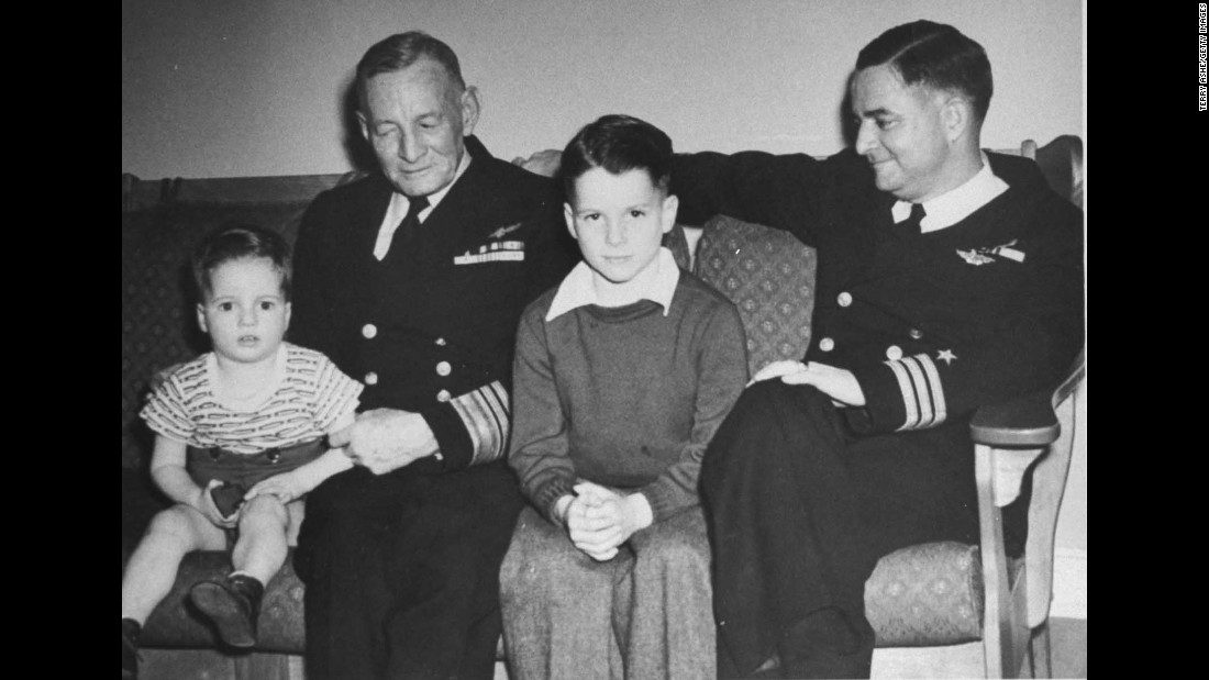 McCain sits with his grandfather and his father, both of whom were Navy admirals, in this family photo from the 1940s.