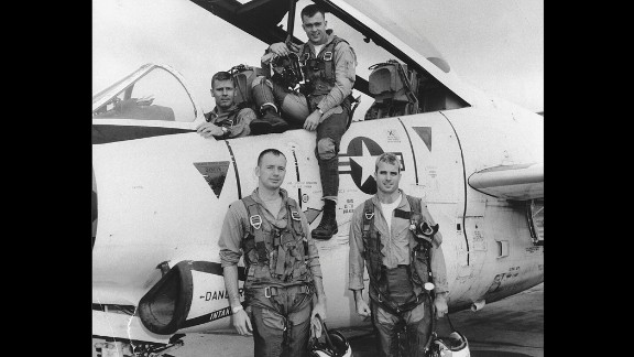 McCain, bottom right, poses with his Navy squadron in 1965.