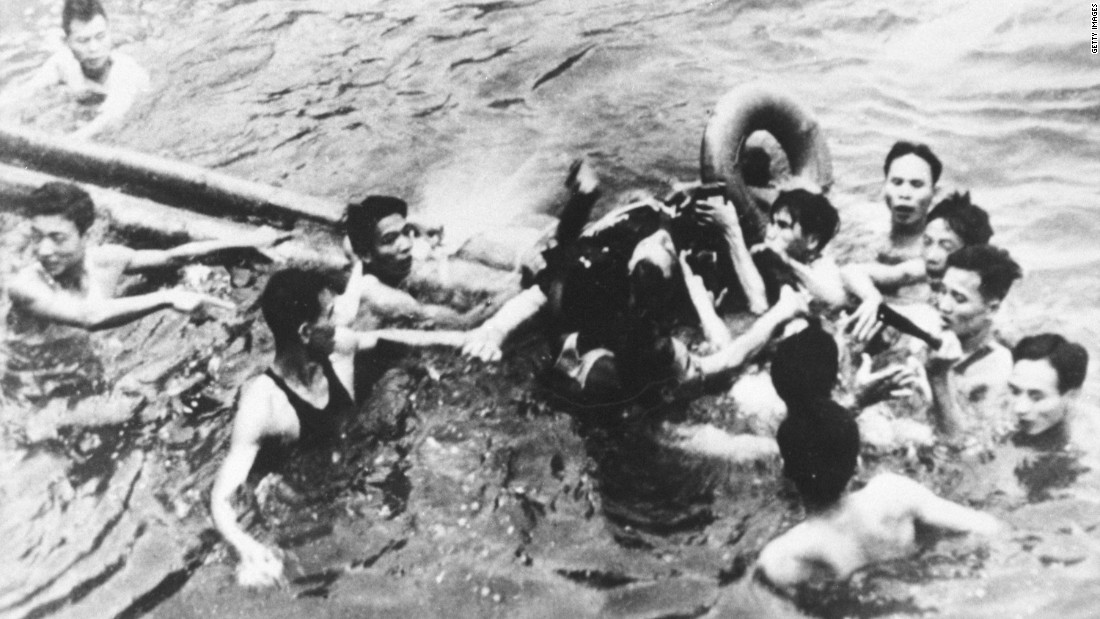 McCain Is pulled out of a Hanoi lake by North Vietnamese army soldiers and civilians on October 26, 1967. McCain broke both arms and his right knee upon ejection and lost consciousness until he hit the water. Upon capture, McCain was beaten, he has said. He was held for five years by the North Vietnamese and tortured.