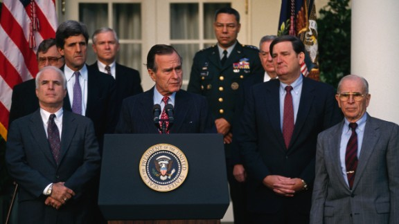 McCain, left, joins President George H.W. Bush at a news conference about soldiers missing in action during the Vietnam War.