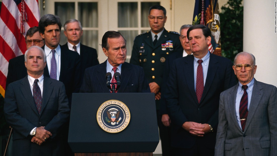 Sen. John McCain, Sen. John Kerry, President George H.W. Bush, Joint Chiefs Chairman Gen. Colin Powell, Gen. John Vessey and others attend a news conference about soldiers missing in action during the Vietnam War.
