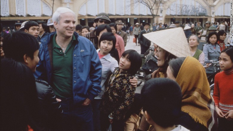 "McCain talks with people in Hanoi, Vietnam, during the filming of the CBS special, ""Honor, Duty and a War Called Vietnam"" in 1985."