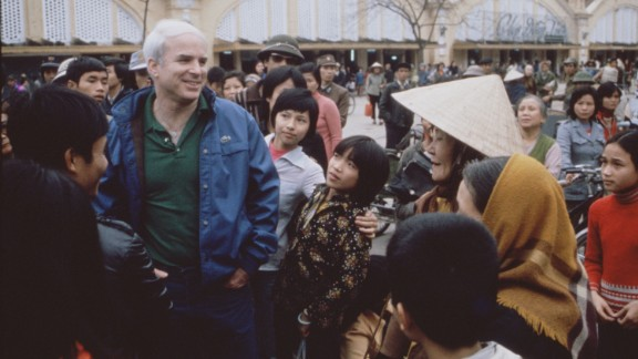 """McCain talks with people in Hanoi, Vietnam, during the filming of the CBS special, """"Honor, Duty and a War Called Vietnam"""" in 1985."""