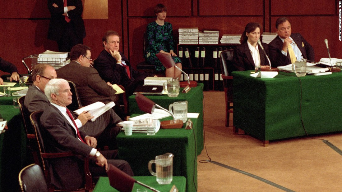 McCain, bottom, attends a hearing of the Senate Ethics Committee in 1990. McCain was investigated as being one of five senators, called the Keating Five, who interfered with regulators on behalf of Charles Keating, a financier accused of financial violations and convicted of securities fraud. McCain was cleared, but the Senate Ethics Committee decided that McCain showed poor judgment in his efforts for Keating, who was a large contributor to McCain's campaign.