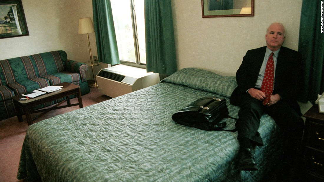 McCain rests in a New Hampshire motel room while on the campaign trail in 1999.