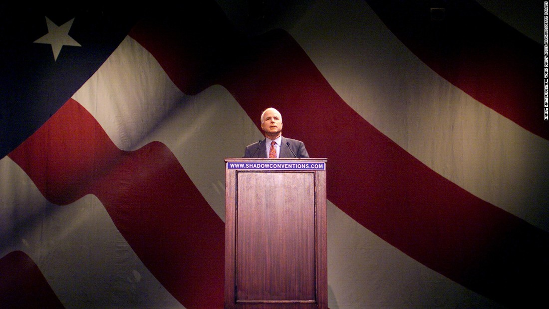 McCain addresses a shadow convention at the University of Pennsylvania in 2000. McCain was booed when he asked supporters to back George W. Bush for President.