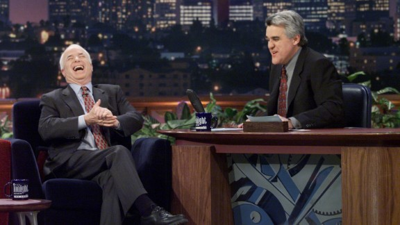 """McCain laughs during an interview with """"Tonight Show"""" host Jay Leno in 2000."""