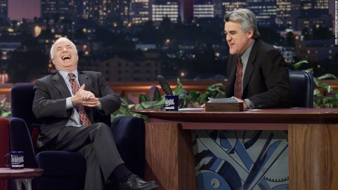"McCain laughs during an interview with ""Tonight Show"" host Jay Leno in 2000."