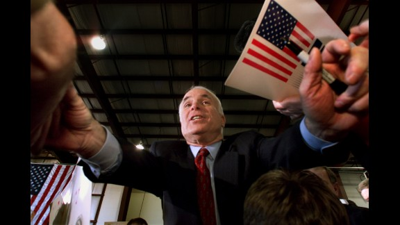 McCain reaches out to supporters during a campaign rally in Portland, Maine, in 2000. He suspended his campaign several days later and eventually endorsed his primary opponent, George W. Bush.
