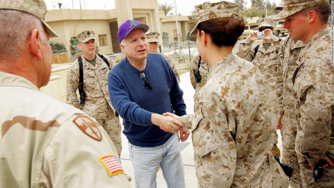 McCain talks with Marines at Camp Falluja in Iraq during a stop with fellow senators Hillary Clinton, Susan Collins, Lindsey Graham and Russ Feingold.