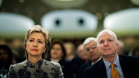 McCain and fellow US Sen. Hillary Clinton listen to President George W. Bush speak at the National Prayer Breakfast in 2007.