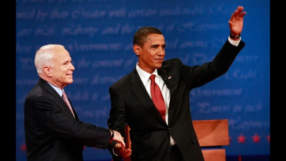 McCain shakes hands with US Sen. Barack Obama, the Democratic presidential nominee, before their first debate in 2008. Obama defeated McCain in the general election.