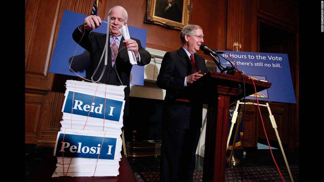 McCain and Senate Republican Leader Mitch McConnell speak about health care reform on December 18, 2009, on Capitol Hill. They vowed that their GOP colleagues would do everything possible to delay passage of any health care legislation, including reading lengthy bills from the floor.