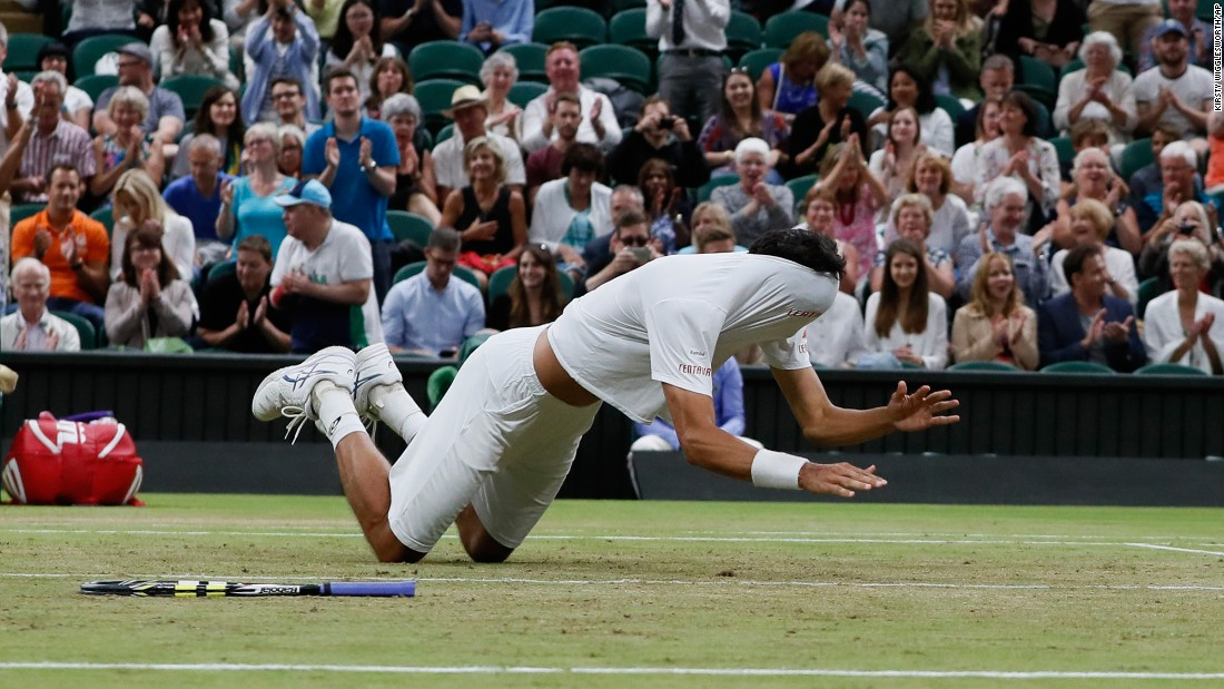 Brazil's Marcelo Melo falls to the ground with his shirt covering his face as he celebrates after he and his playing partner, Poland's Lukasz Kubot, defeated Austria's Oliver Marach and Croatia's Mate Pavic in the Men's Doubles final match on Saturday, July 15, at the Wimbledon Tennis Championships in London.