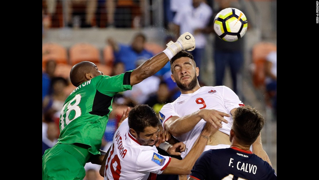 "Costa Rica goalkeeper Patrick Pemberton, left, makes a save against Canada forward Lucas Cavallini, No. 9, in the second half of a <a href=""https://www.mlssoccer.com/post/2017/07/11/costa-rica-1-canada-1-2017-concacaf-gold-cup-match-recap"" target=""_blank"">CONCACAF Gold Cup soccer match</a> in Houston on Tuesday, July 11."